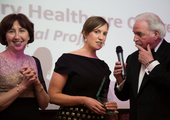 Marty Wheelan presents an award to The Crystal Project
